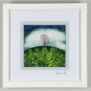 enamel picture of a single tree on a hill. made by Jeanette Hannaby