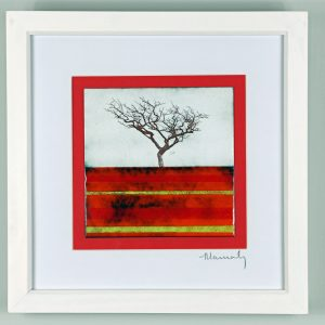 Enamel picture of a windswept tree on a base of rich reds