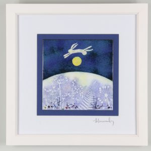 Enamel picture of a hare leaping over the moon.