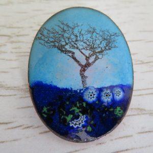 Blue enamel brooch with tree