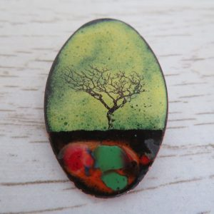 yellow enamel brooch with tree