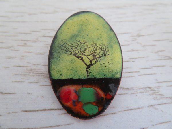 yellow enamel brooch with tree