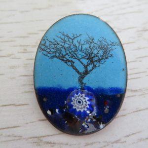Blue enamel brooch with tree by Jeanette Hannaby