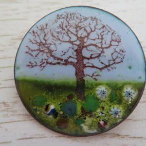 Enamel brooch with tree by Jeanette Hannaby