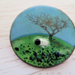 Enamel brooch with a tree and a sheep