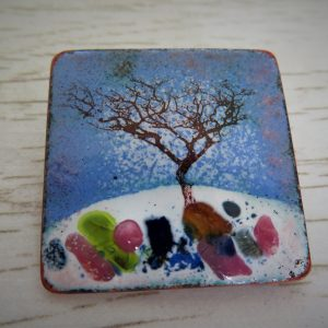 Enamel brooch with a tree